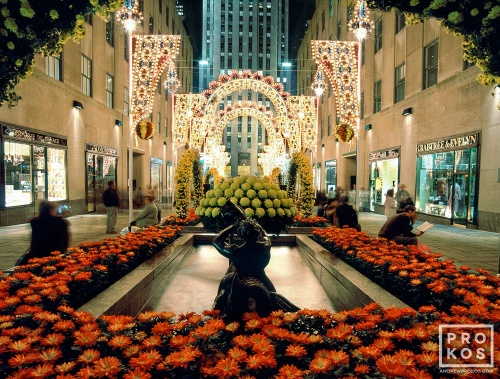 A high-definition photo of Rockefeller Center's Channel Gardens illuminated at night