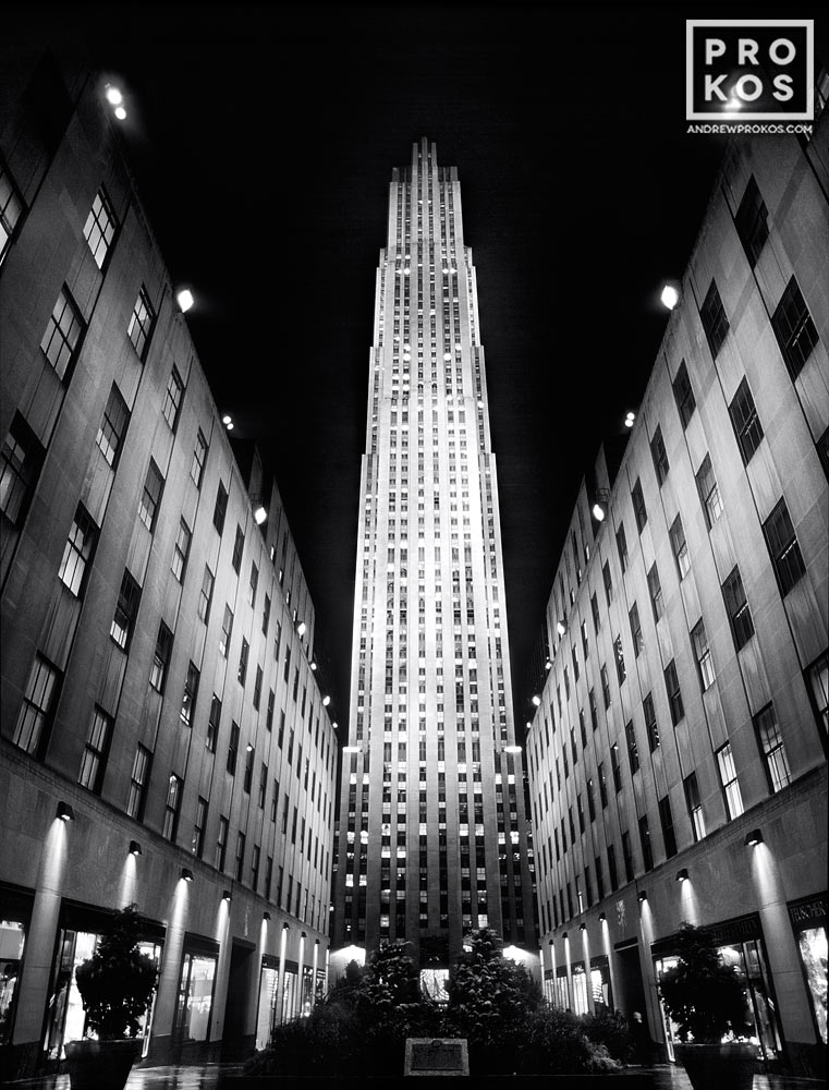 A black and white architectural photo of Rockefeller Center at night, New York City