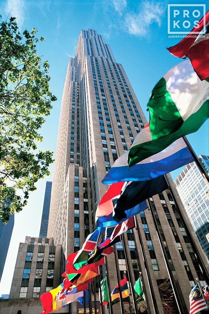 A daytime view of Rockefeller Center with flags of the world, New York City