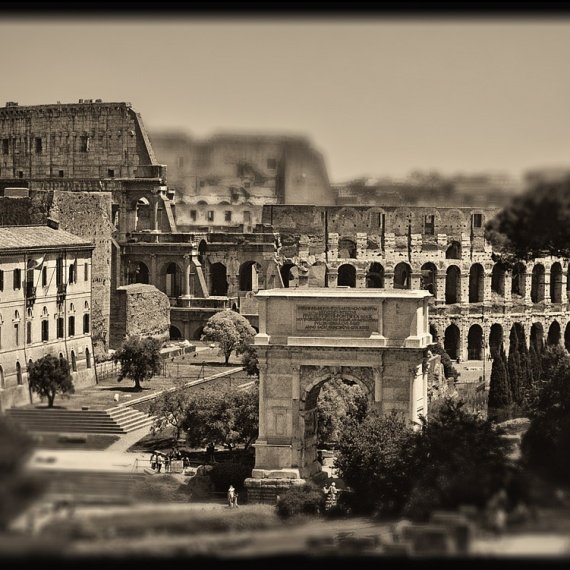 A view of the Colosseum and the Arch of Titus in the ancien Roman Forum. From the monochrome photo series