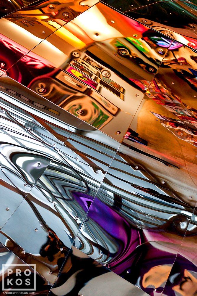 "An abstract fine art photo of colorful reflections from a polished metal surface from the series ""Audacity of Color"""