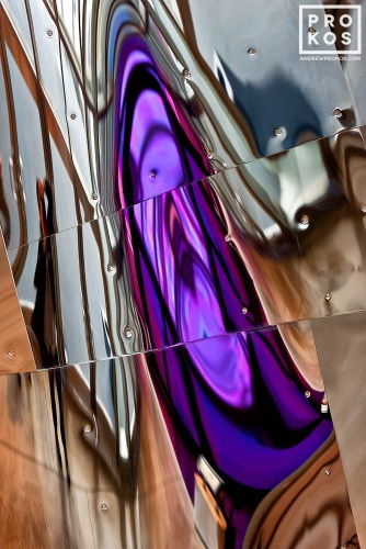 "An abstract fine art photo of colorful reflections in tones of purple and silver on a polished metal surface. From the series ""Audacity of Color"""