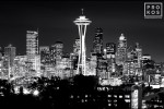 A photograph of the Seattle, Washington skyline at night in black and white