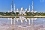 A color fine art photo of Sheikh Zayed Grand Mosque reflected in the pool at Wahat al Karama, Abu Dhabi, UAE