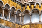 A fine art architectural photo of a neo-gothic colonnade from the Palacio da Pena in Sintra, Portugal