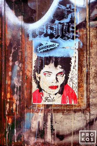 Graffiti and a poster of Michael Jackson the door of a Soho loft building, New York City