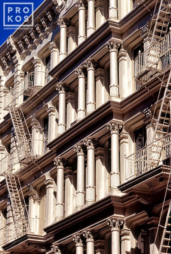 An architectural photo of the ornate cast iron facade of a Soho loft building, New York City