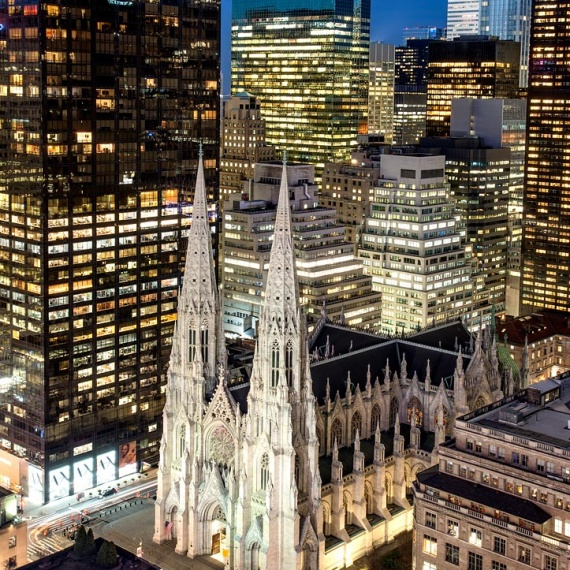A view of St. Patrick's Cathedral and the skyscrapers of Midtown Manhattan at Night