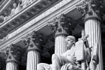 A black and white fine art architectural photo of the U.S. Supreme Court with Guardian of Law statue in the foreground, Washington DC