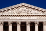 A panoramic architectural photo of the United States Supreme Court building's West Pediment, Washington DC
