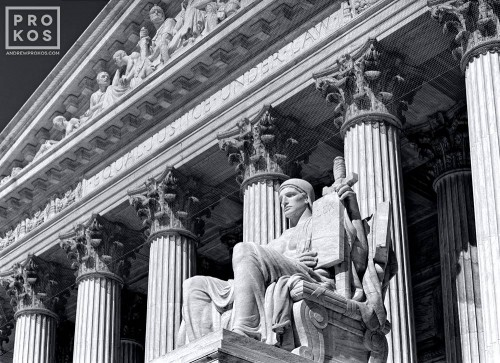Facade of the US Supreme Court in black and white, with the Guardian of Law statue in the foreground, Washington DC