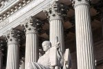 A color architectural photo of the United States Supreme Court with the 'Guardian of Law' statue, Washington DC