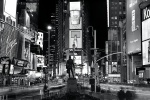 A panoramic view of Times Square at night in black and white, New York City