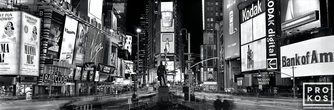 An ultra high-definition panoramic view of Times Square at night in black and white, New York City. Large-scale fine art prints of this photo are available up to 120 inches wide.
