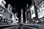 A wide angle view of Times Square at night in black and white, New York City