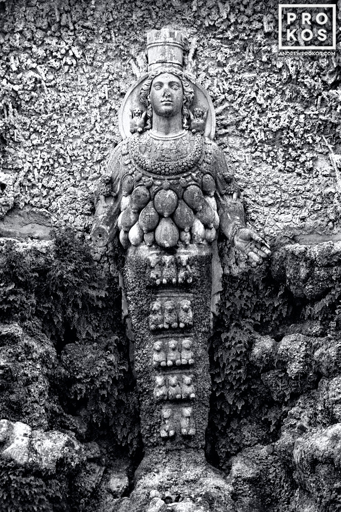 A black and white fine art photo of the statue of the Ephesian Diana in the Villa D'Este Gardens, Tivoli, Italy