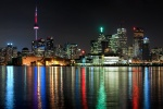 A panoramic skyline photograph of Toronto, Canada at night. Large-scale fine art prints of this photo are available in sizes up to 120 inches wide.