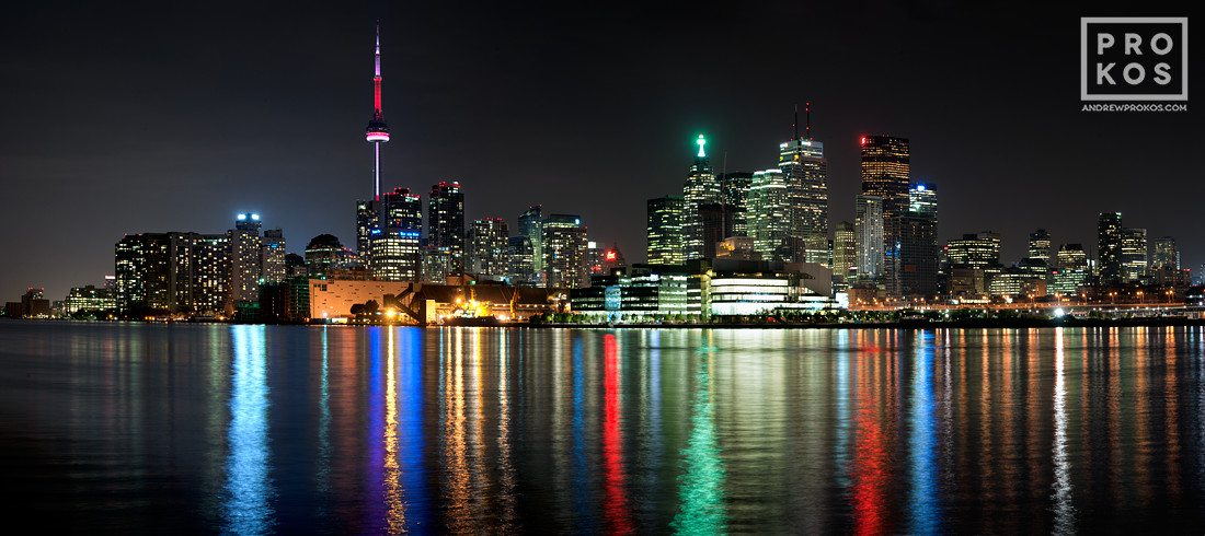 "A <a href=""/photos/panoramas/"">panoramic skyline</a> of <a href=""/tags/toronto-canada/"">Toronto, Canada</a> at <a href=""/photos/night/"">night</a>. <a href=""/fine-art-prints/"">Large-scale fine art prints</a> of this photo are available in sizes up to 120 inches wide."