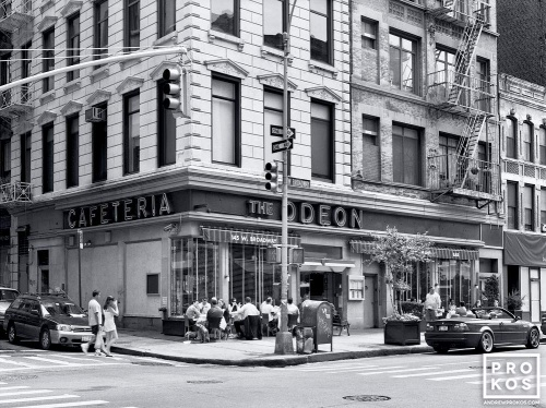 A black and white street scene showing the landmark Odeon Restaurant in Tribeca, New York City