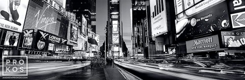 A panoramic cityscape photo of Times Square at dusk in black and white, New York City.