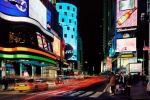An ultra high-definition panoramic photo of the signs of New York City's Times Square at night taken with a long exposure. Large-scale fine art prints of this photo are available up to 120 inches wide.