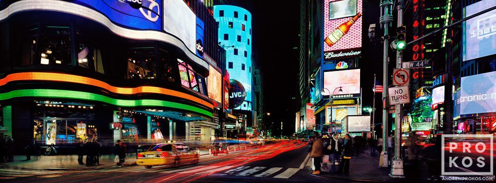 An ultra high-definition panoramic photo of the signs of New York City's Times Square at night taken with a long exposure.