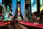 A panoramic long-exposure cityscape photo of Times Square at dusk, New York City