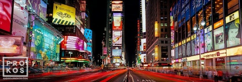 A panoramic photograph of Times Square at night, New York City.