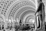 A black and white fine art architectural photo of the sweeping interior of Union Station's Main Hall in Washington DC