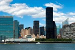 A panoramic skyline photo of East Midtown Manhattan, the East River, and the United Nations buildings in New York City