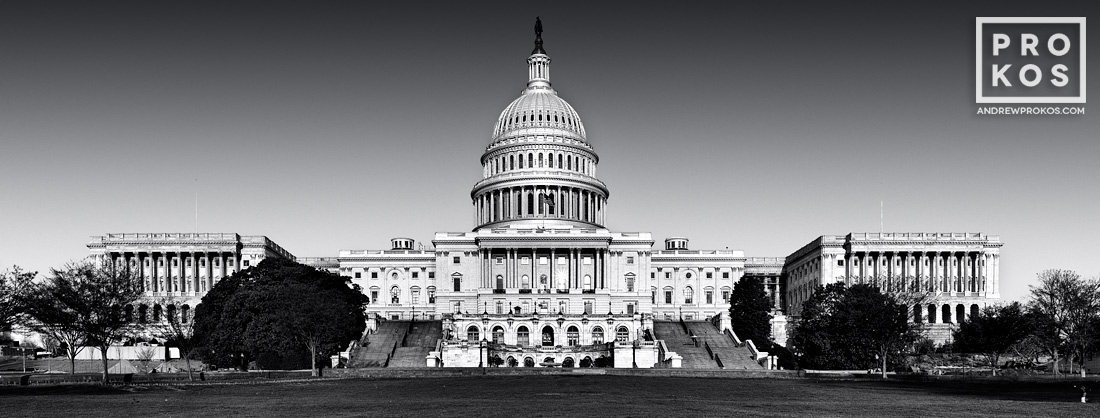 A panoramic large-format view of the United States Capitol Building's West Front in black and white, Washington D.C.