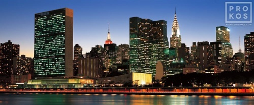 A panoramic cityscape photo of the Midtown Manhattan skyline and the United Nations at dusk, New York City.
