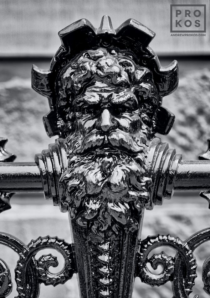An architectural detail from the cast-iron railing on the Dakota building on Manhattan's Upper West Side in black and white