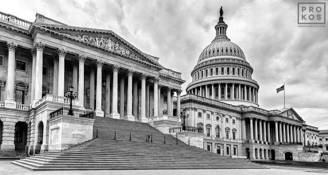 A panoramic architectural photo of the East Front of the U.S. Capitol building in black and white, Washington D.C.