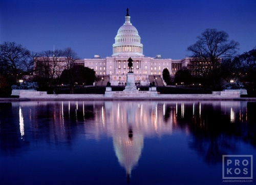 A photo of the United States Capitol building reflected in the Reflecting Pool at night, Washington D.C.