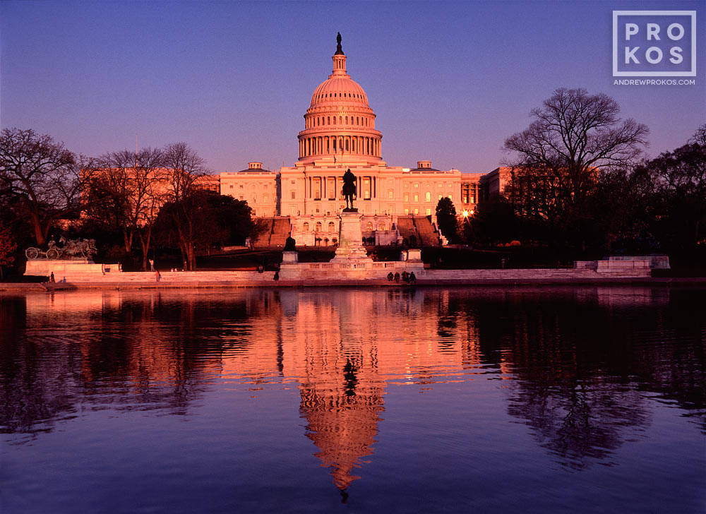 A landscape photo of the United States Capitol building reflected in the Reflecting Pool at sunset, Washington D.C.