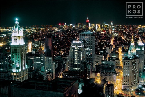 An aerial view of Lower Manhattan at night showing the Woolworth Building and the Municipal Building, New York City