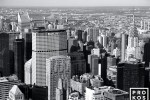 A black and white cityscape photo of the skyscrapers of Midtown Manhattan from the Empire State Building, New York City