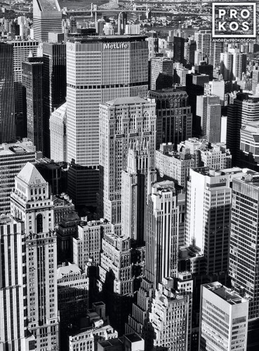 A black and white cityscape photo of the skyscrapers of Midtown Manhattan as seen from the top of the Empire State Building, New York City