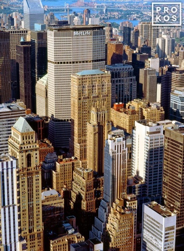 A color cityscape photo of the skyscrapers of Midtown Manhattan as seen from the top of the Empire State Building in New York City