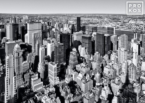 A black and white aerial view of the skyscrapers of Midtown Manhattan, New York City