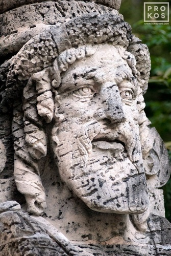 An architectural detail of an allegorical coralstone herm in the gardens of Vizcaya Museum, Miami, Florida