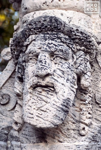Photo of an allegorical herm made of coralstone in the gardens of Vizcaya Museum, Miami, Florida