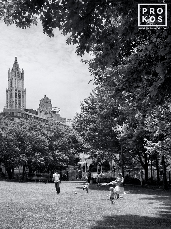 A family playing in Washington Market Park in Tribeca, New York City