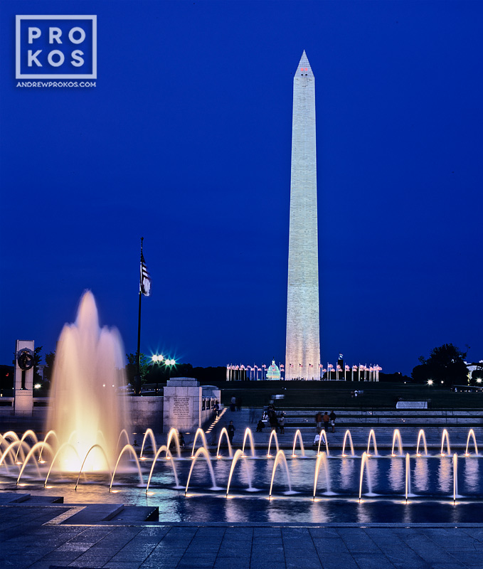 A long-exposure night photo of the Washington Monument as seen from the World War II Memorial in Washington, DC