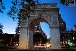 An architectural photo of the monumental arch at Washington Square at night, New York City