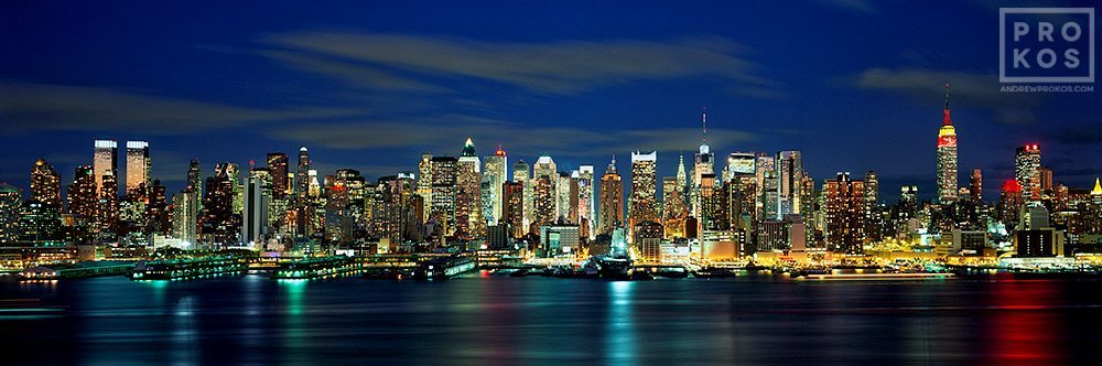 A panoramic skyline of Midtown Manhattan at night from Weehawken, New Jersey.