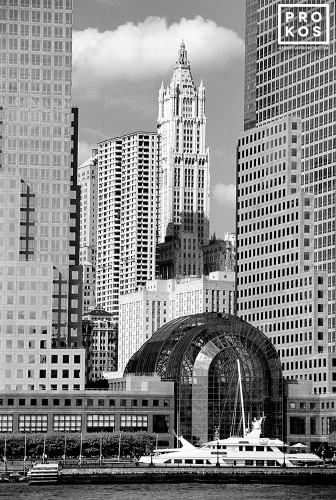 A black and white photo of the World Financial Center and Woolworth Building from the Hudson River, New York City