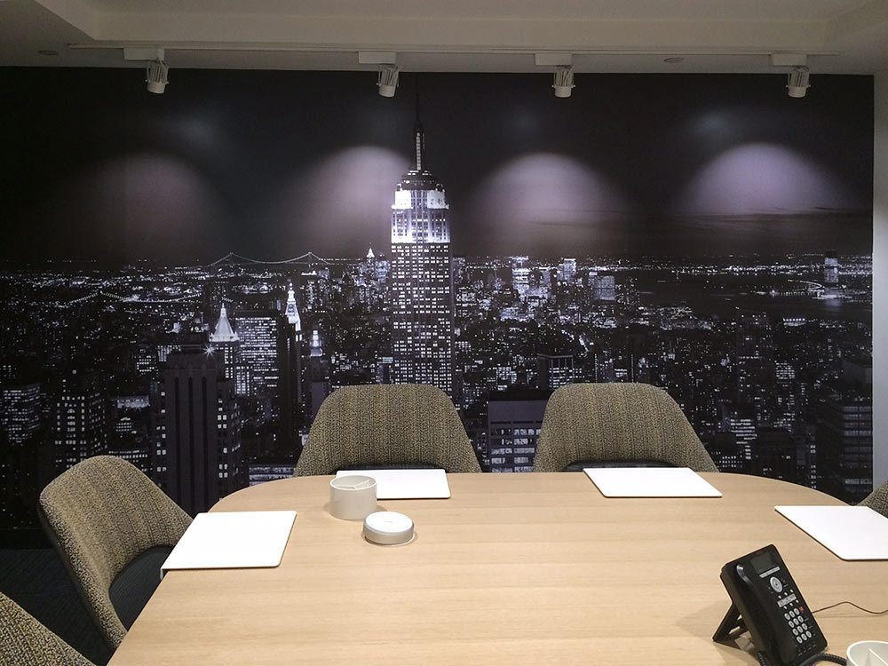 Wall mural of New York City skyline at night by photographer Andrew Prokos