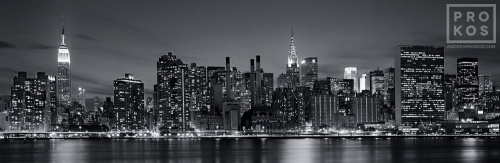 A black and white panoramic skyline photograph of Midtown Manhattan at Night